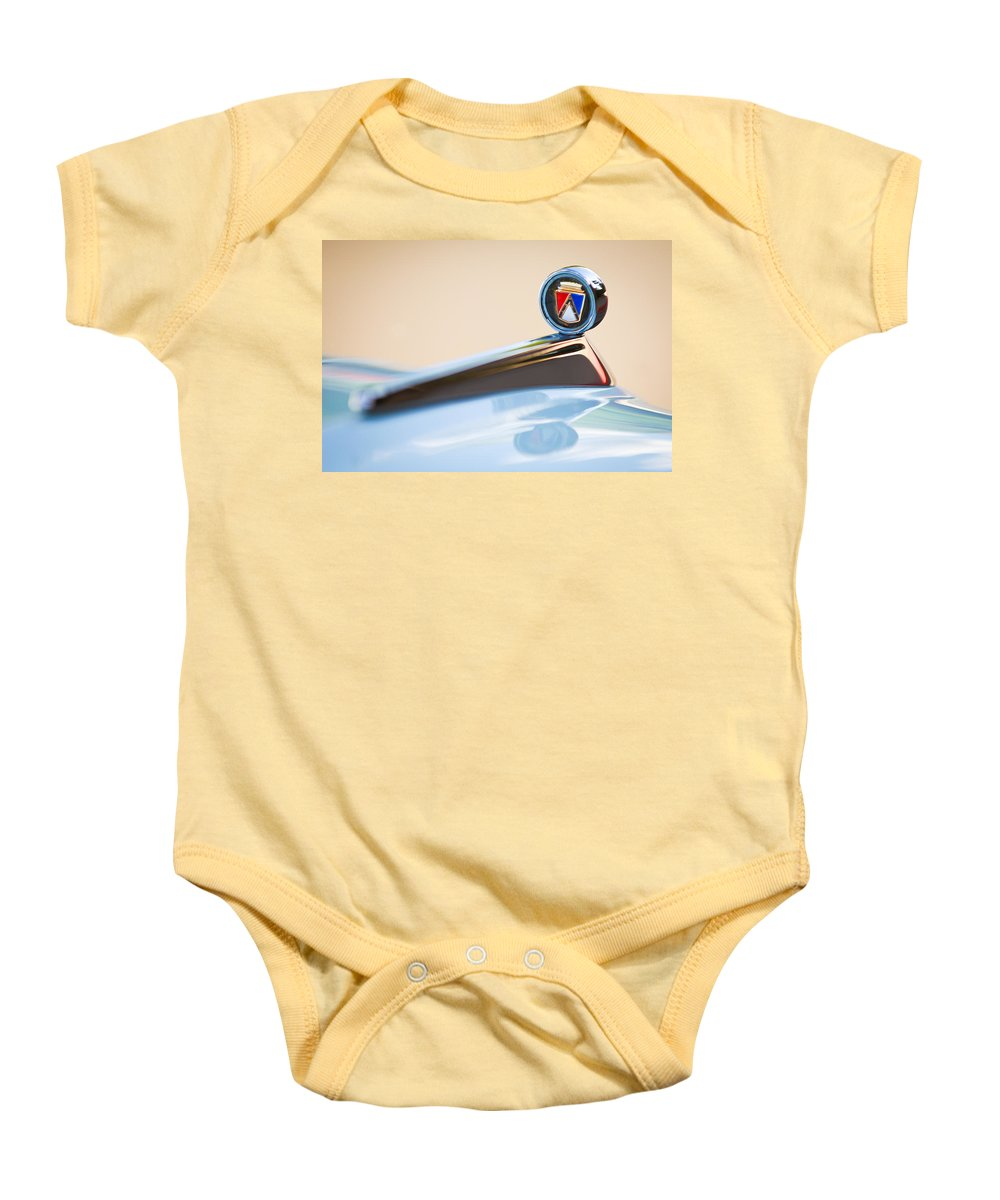 1963 Ford Falcon Futura Convertible Hood Ornament Baby Onesie featuring the photograph 1963 Ford Falcon Futura Convertible Hood Ornament by Jill Reger