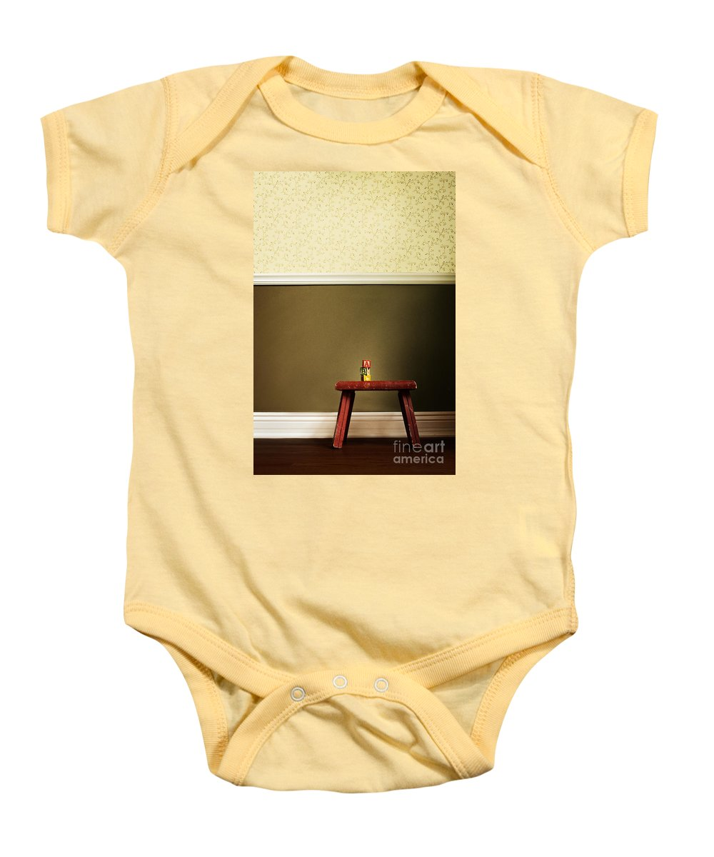 Stool; Step; Red; Blocks; Abc; Spelling; Words; Tower; Built; Toys; Play; Child; Children; Wall; Wallpaper; Floor; Wood; Vintage; Still Life Baby Onesie featuring the photograph Abc's by Margie Hurwich