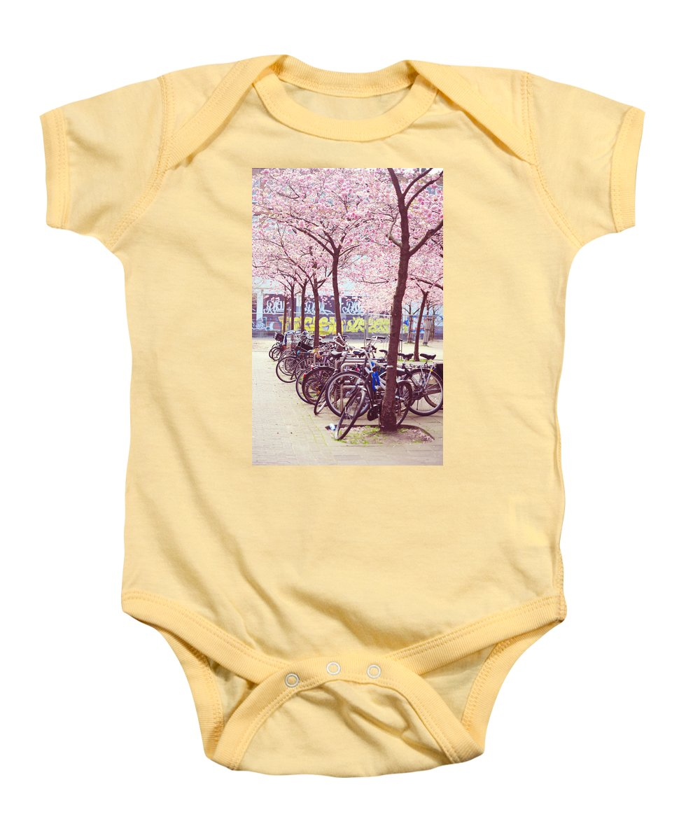 Spring Baby Onesie featuring the photograph Bicycles Under The Blooming Trees. Pink Spring In Amsterdam by Jenny Rainbow