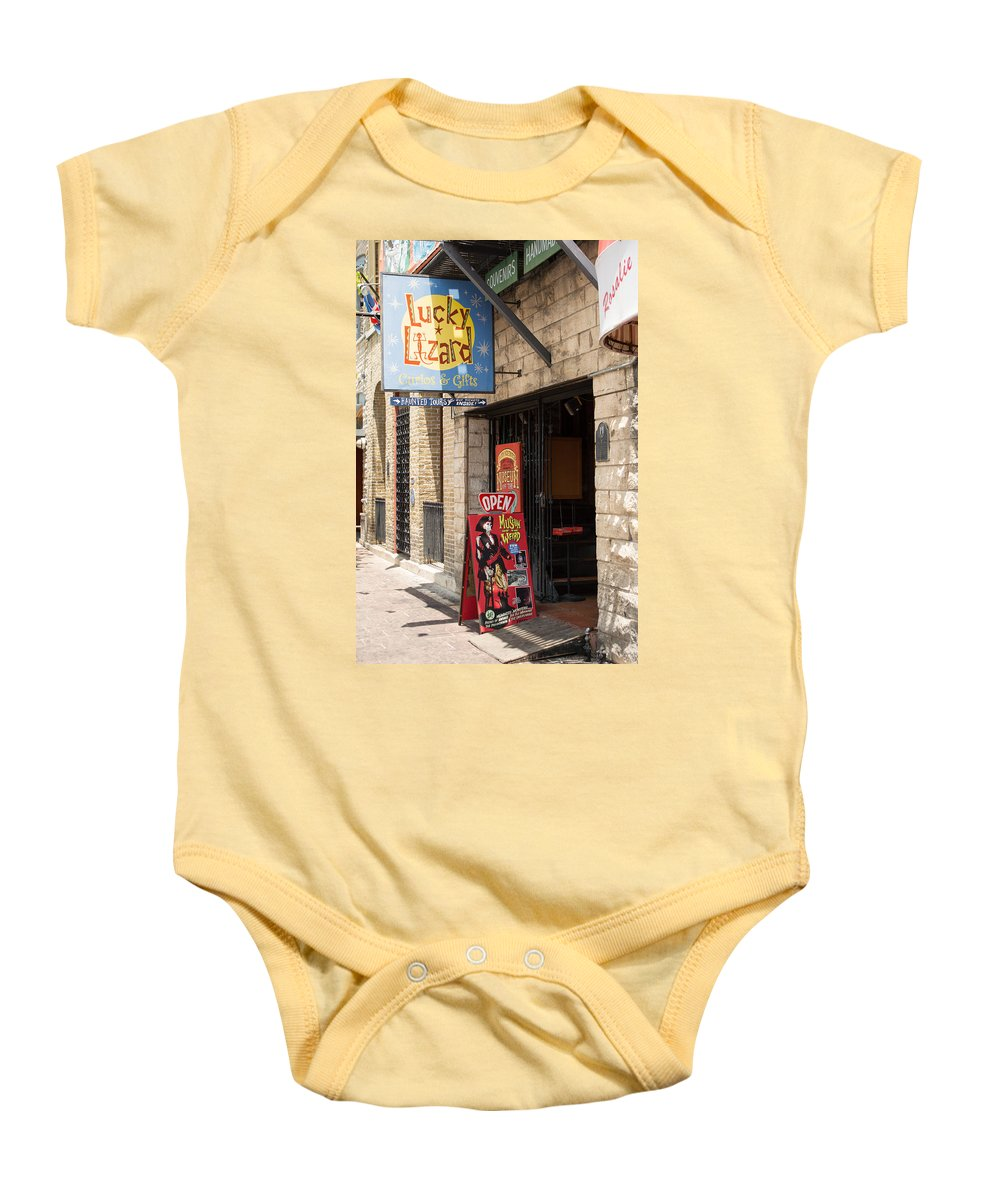 Texas Baby Onesie featuring the photograph Austin Lucky Lizard On Sixth by JG Thompson