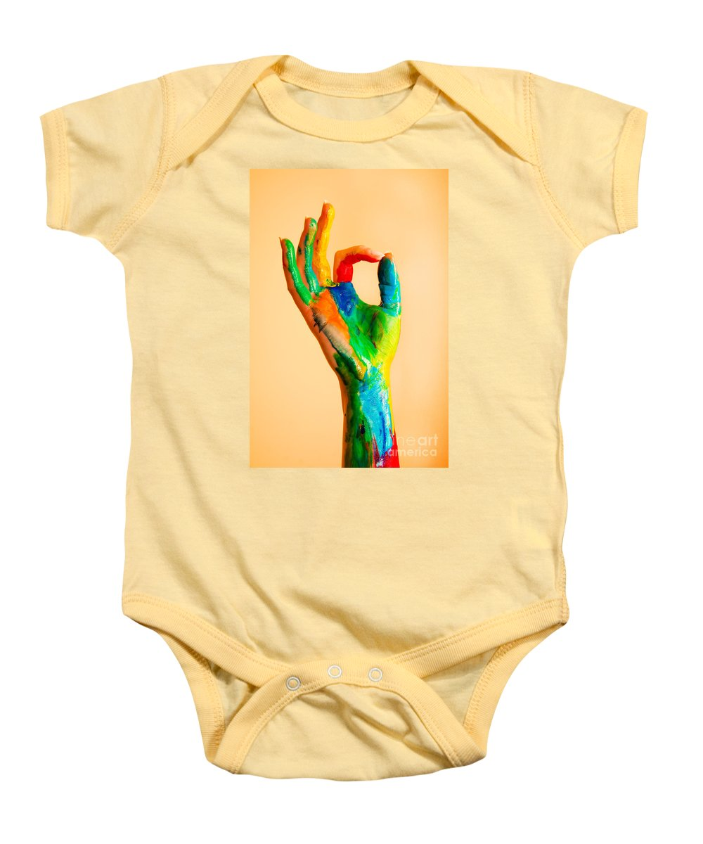 Hand Baby Onesie featuring the photograph Painted Hand With Ok Sign by Michal Bednarek
