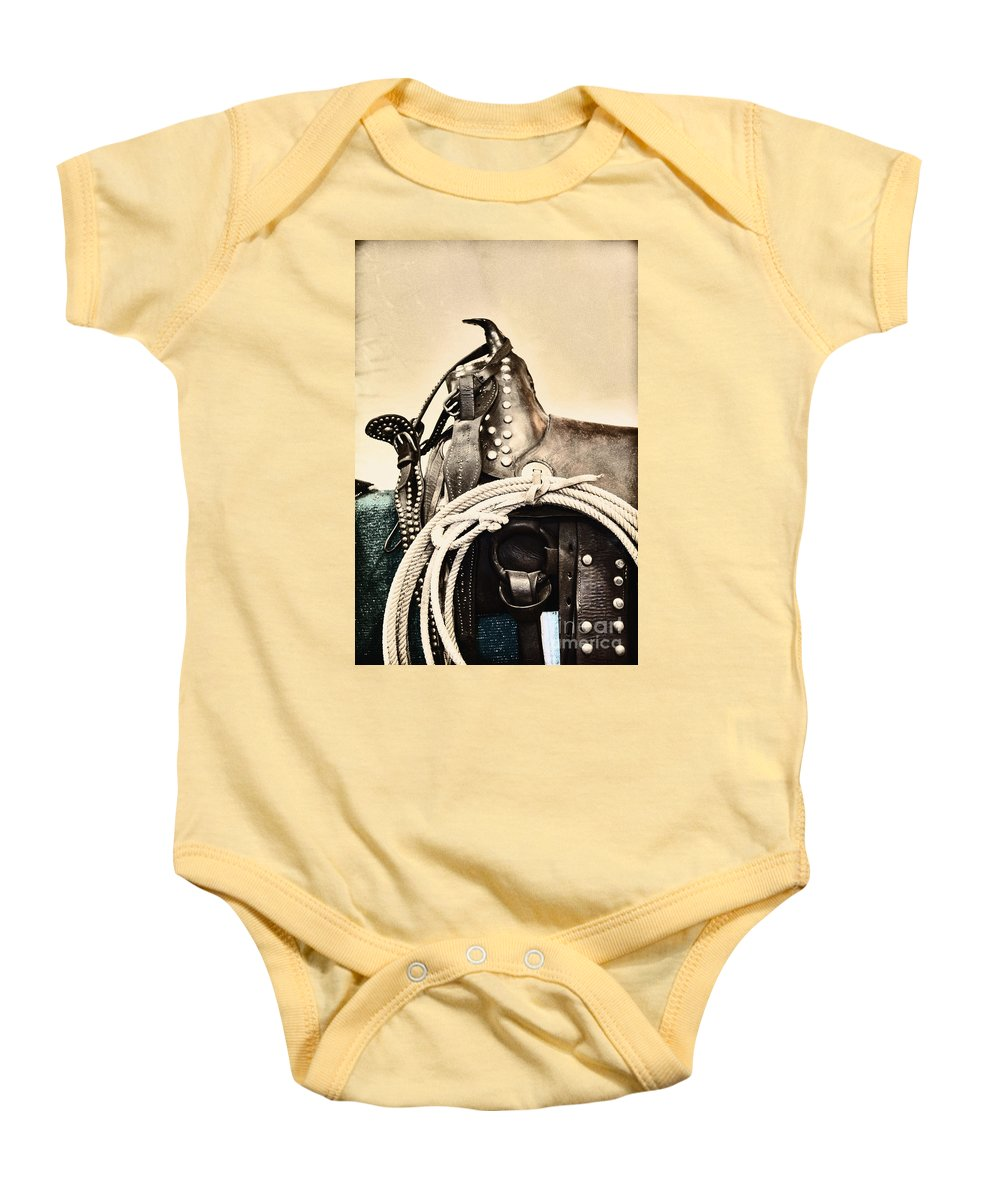 Saddle Baby Onesie featuring the photograph Saddle by Margie Hurwich