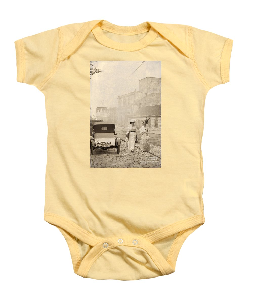 Edwardian Baby Onesie featuring the photograph Two Edwardian Ladies Crossing A Cobbled Street by Lee Avison