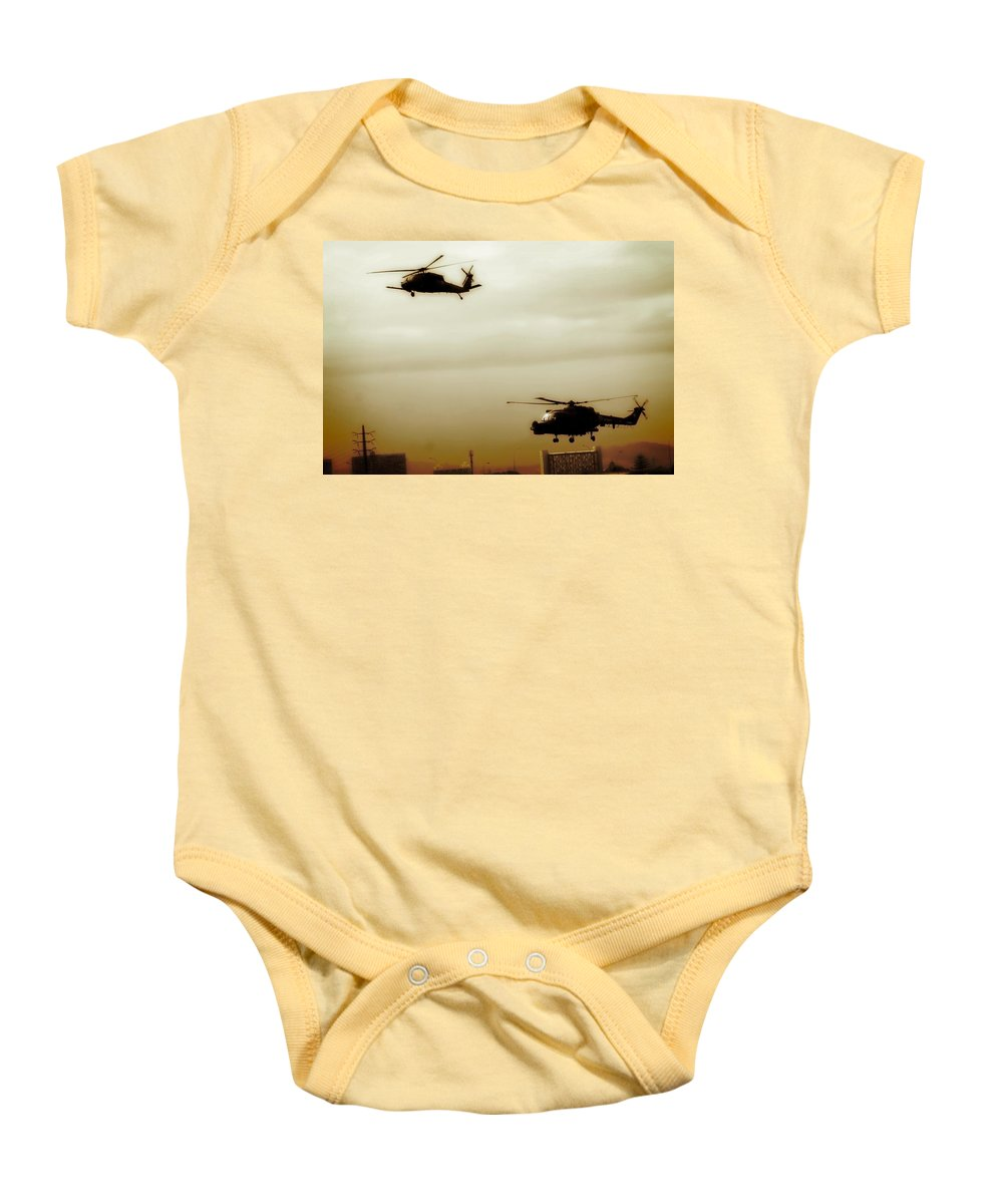 Black Hawk Baby Onesie featuring the photograph War Games by Paul Job