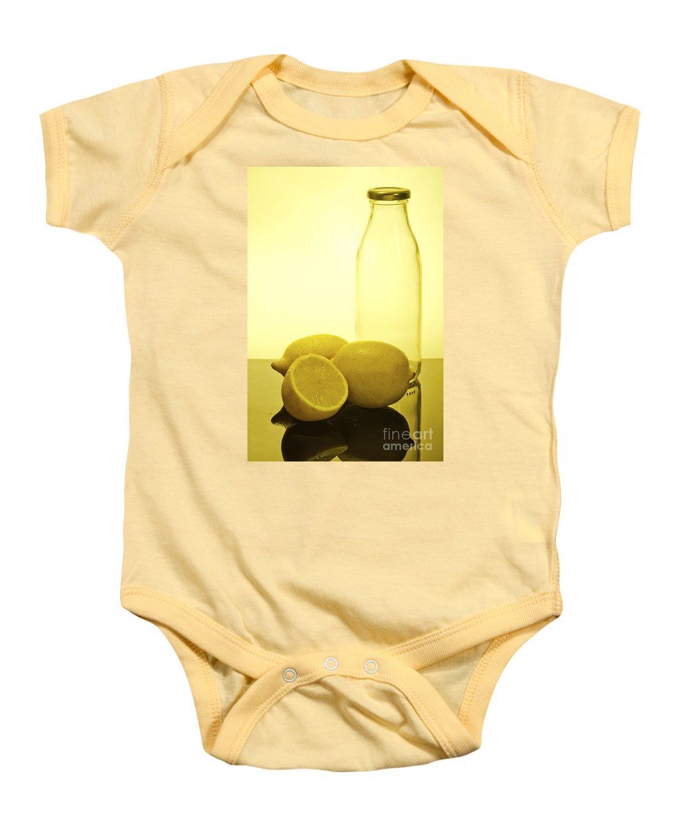 Assortment Baby Onesie featuring the photograph Still Life Of Bottles And Lemons by Ilan Amihai