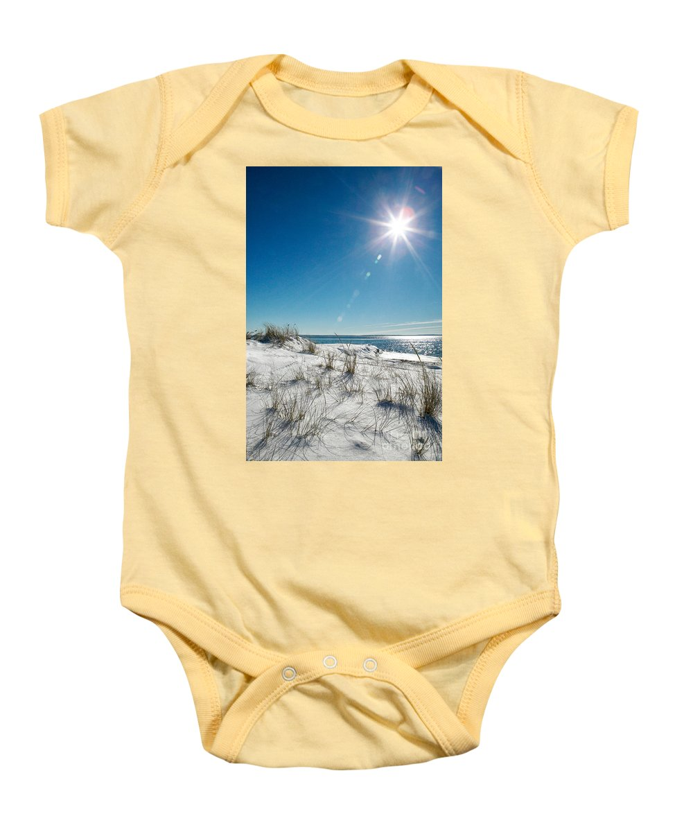 Winter Baby Onesie featuring the photograph The Sun Shines Down On Freshly Fallen Snow On Bristol Beach by Matt Suess