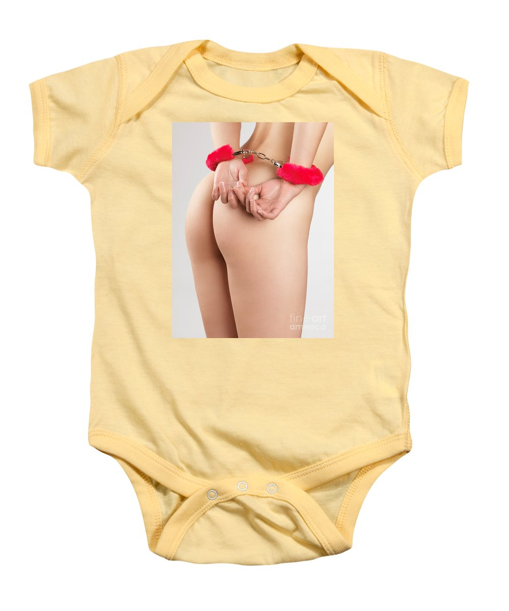 Handcuffs Baby Onesie featuring the photograph Woman Hands In Pink Handcuffs by Oleksiy Maksymenko