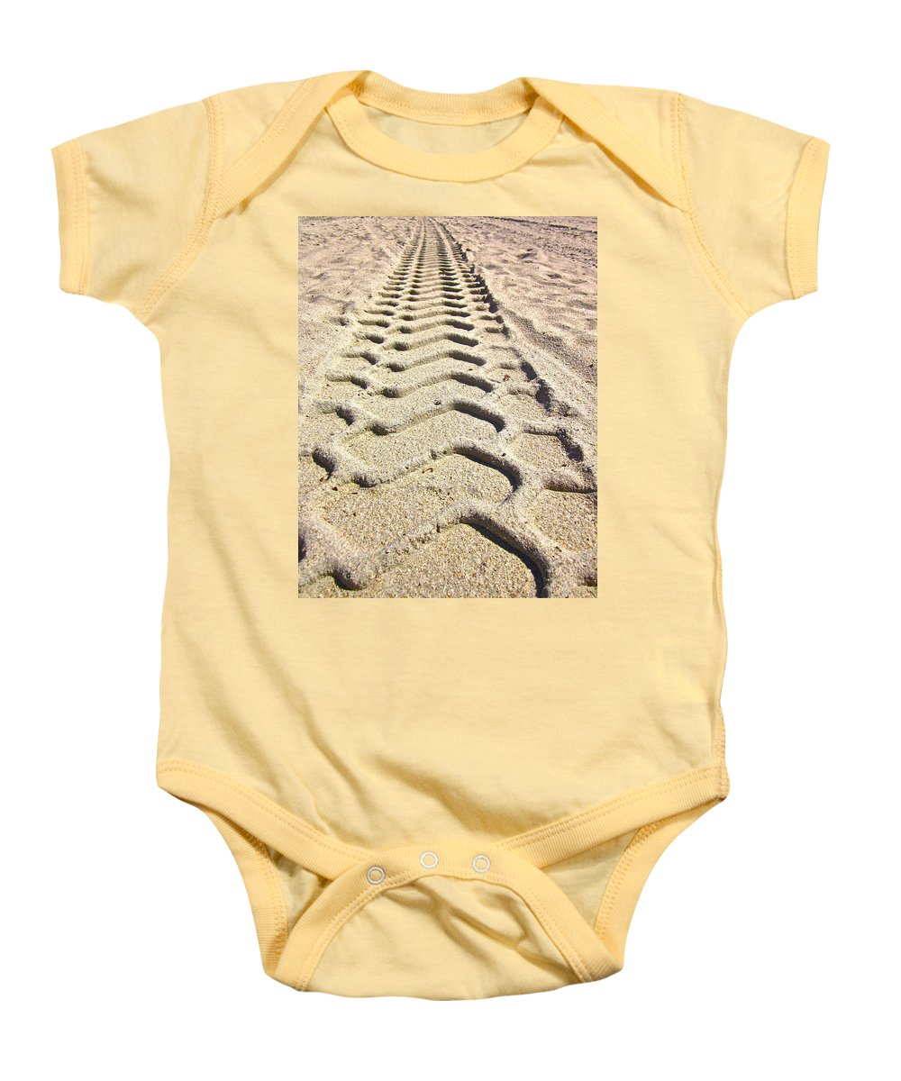 Photograph Of Tire Tracks Baby Onesie featuring the photograph Beach Tracks by Gwyn Newcombe