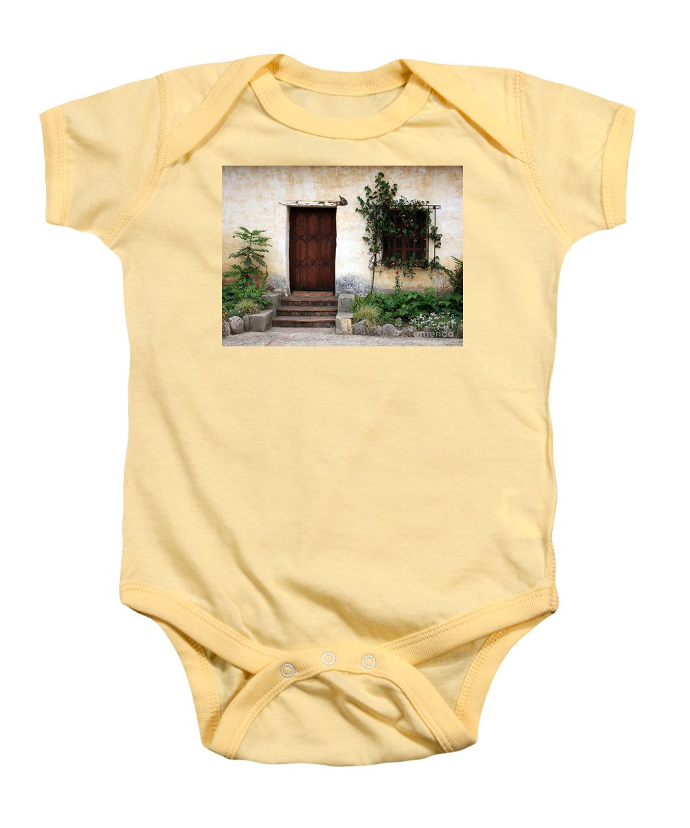 Carmel Mission Baby Onesie featuring the photograph Carmel Mission Door by Carol Groenen