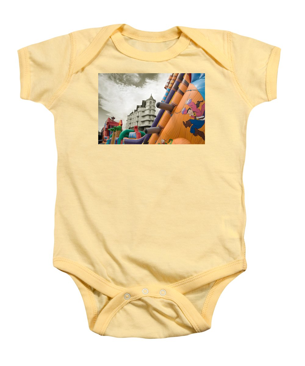 Childrens Baby Onesie featuring the photograph Childrens Play Areas Contrast With The Victorian Elegance Of The Grand Hotel In Llandudno Wales Uk by Mal Bray
