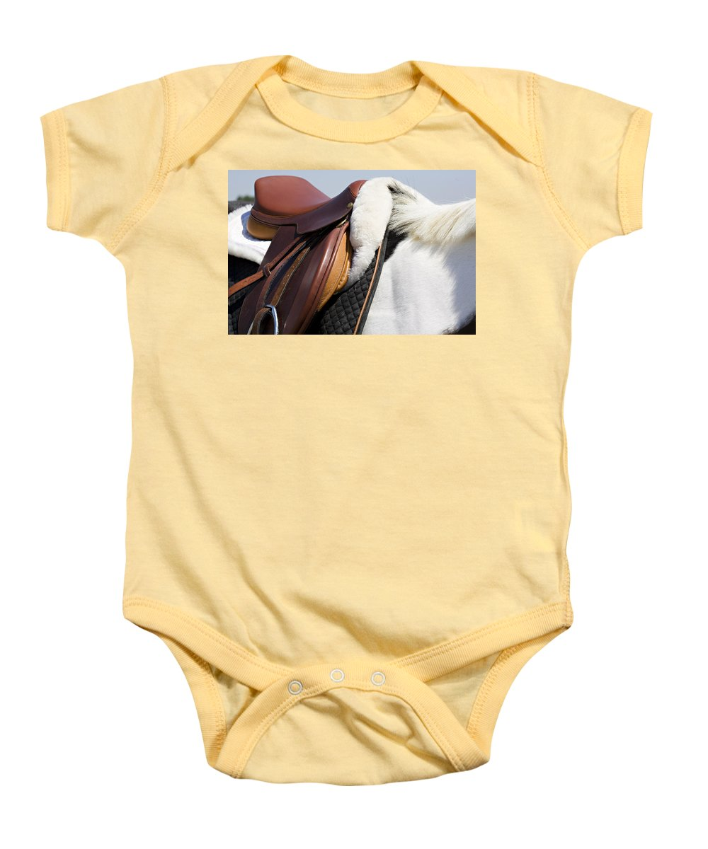 Horse Baby Onesie featuring the photograph White Horse And Saddle by Marilyn Hunt