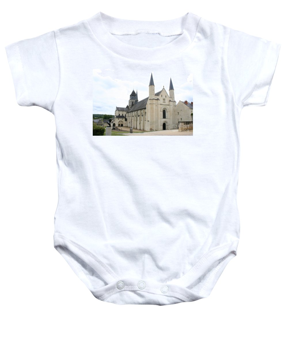 Cloister Baby Onesie featuring the photograph West Facade Of The Church - Fontevraud Abbey by Christiane Schulze Art And Photography