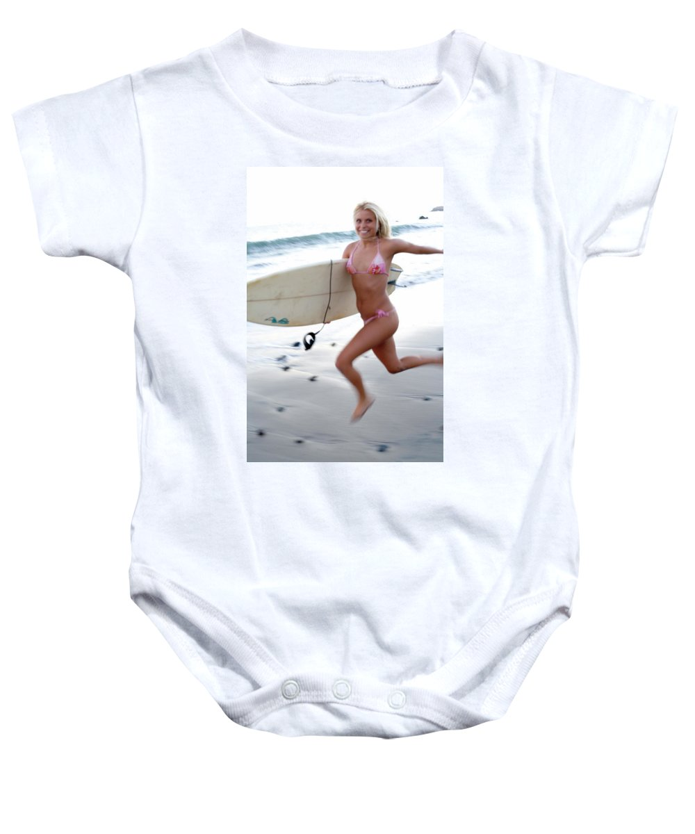 Action Baby Onesie featuring the photograph A Young Woman Is Running by Ed Fox