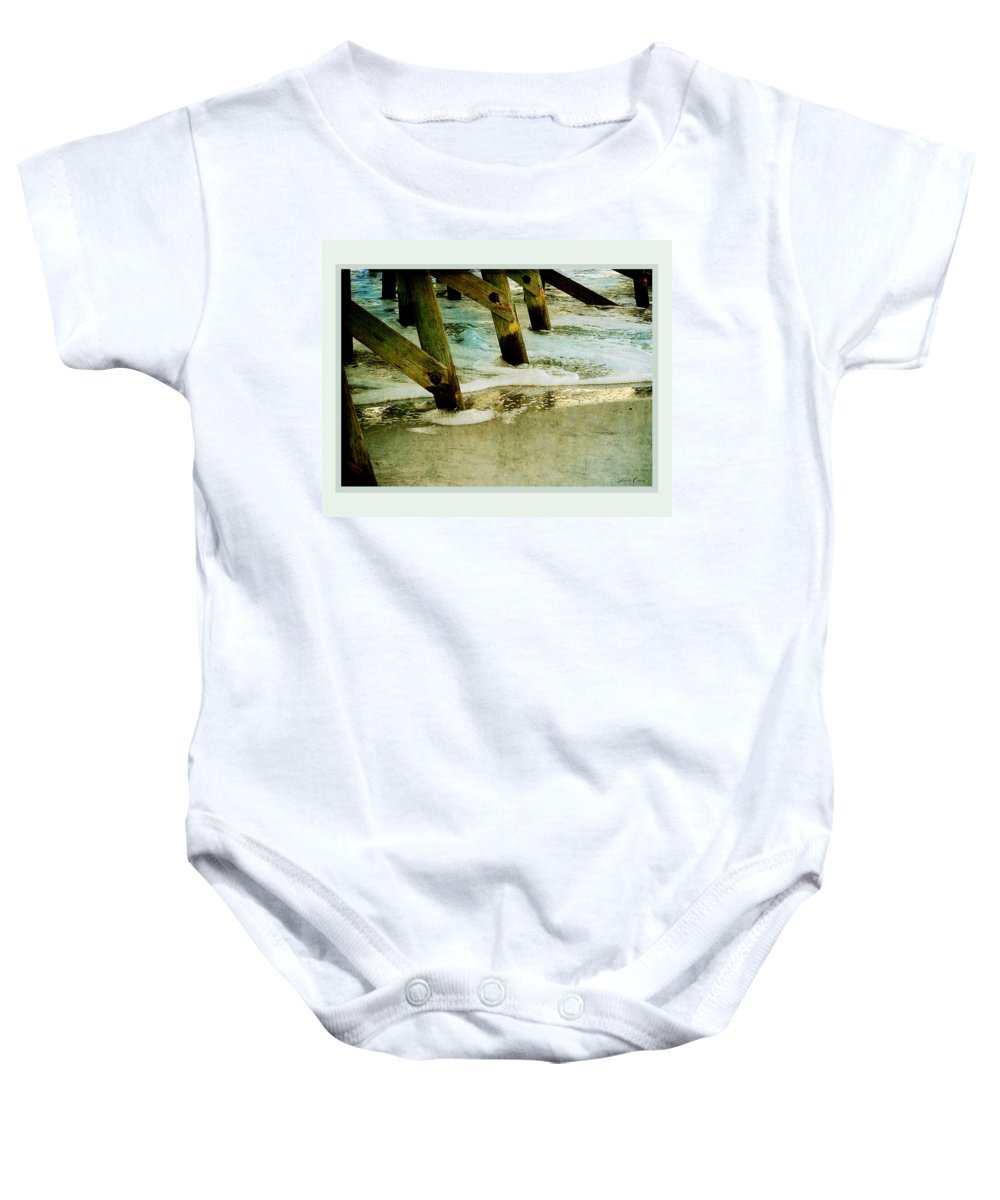 Pier Baby Onesie featuring the photograph Ab Pilings by Linda Olsen