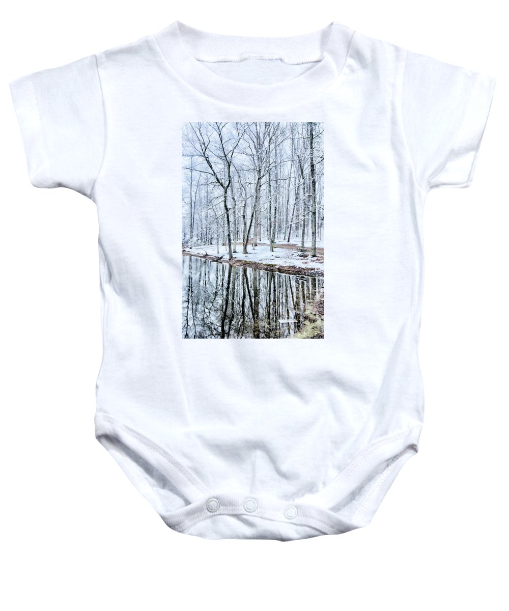 Tree Line Baby Onesie featuring the photograph Tree Line Reflections In Lake During Winter Snow Storm by Alex Grichenko