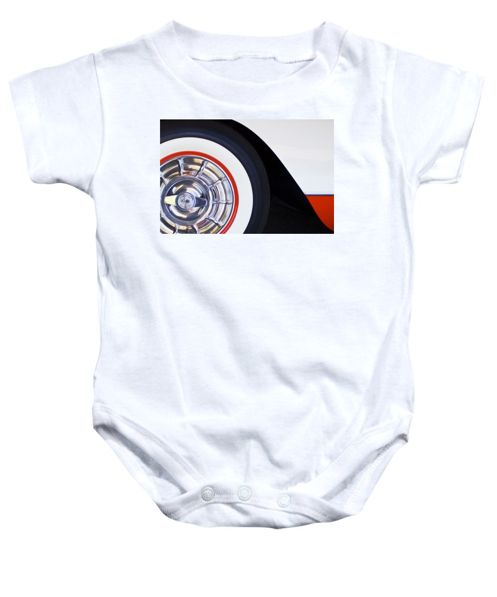 1957 Chevrolet Corvette Convertible Wheel Baby Onesie featuring the photograph 1957 Chevrolet Corvette Wheel by Jill Reger