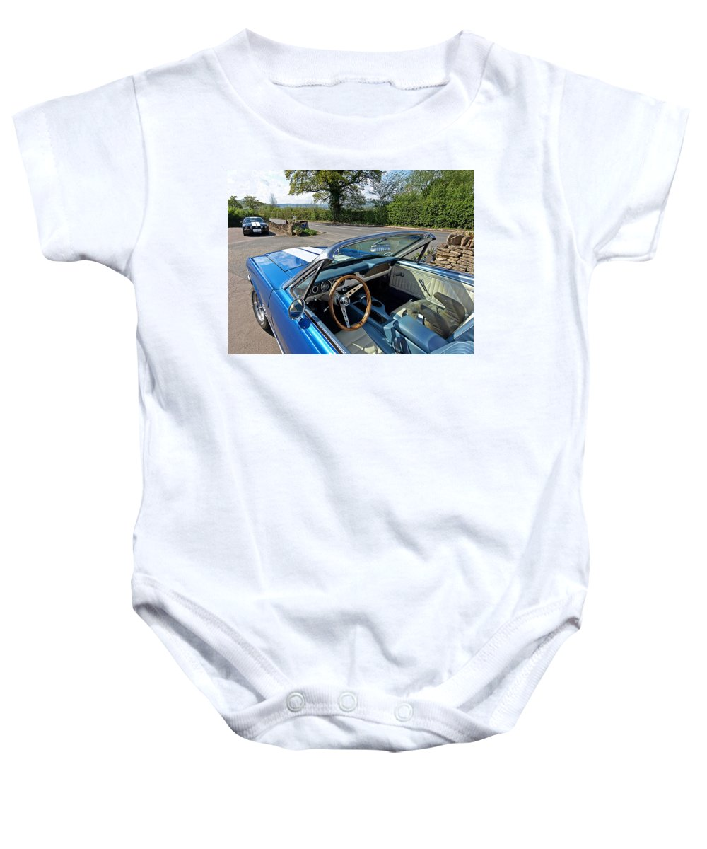 Ford Mustang Baby Onesie featuring the photograph 1966 Convertible Mustang On Tour In The Cotswolds by Gill Billington