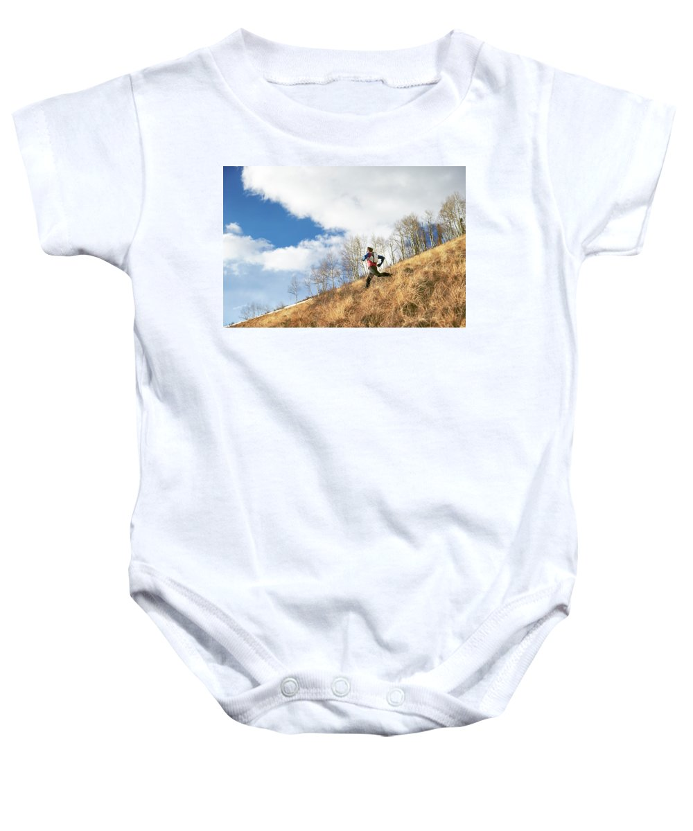 Full Length Baby Onesie featuring the photograph An Adult Male Trail Running by Andrew Maguire