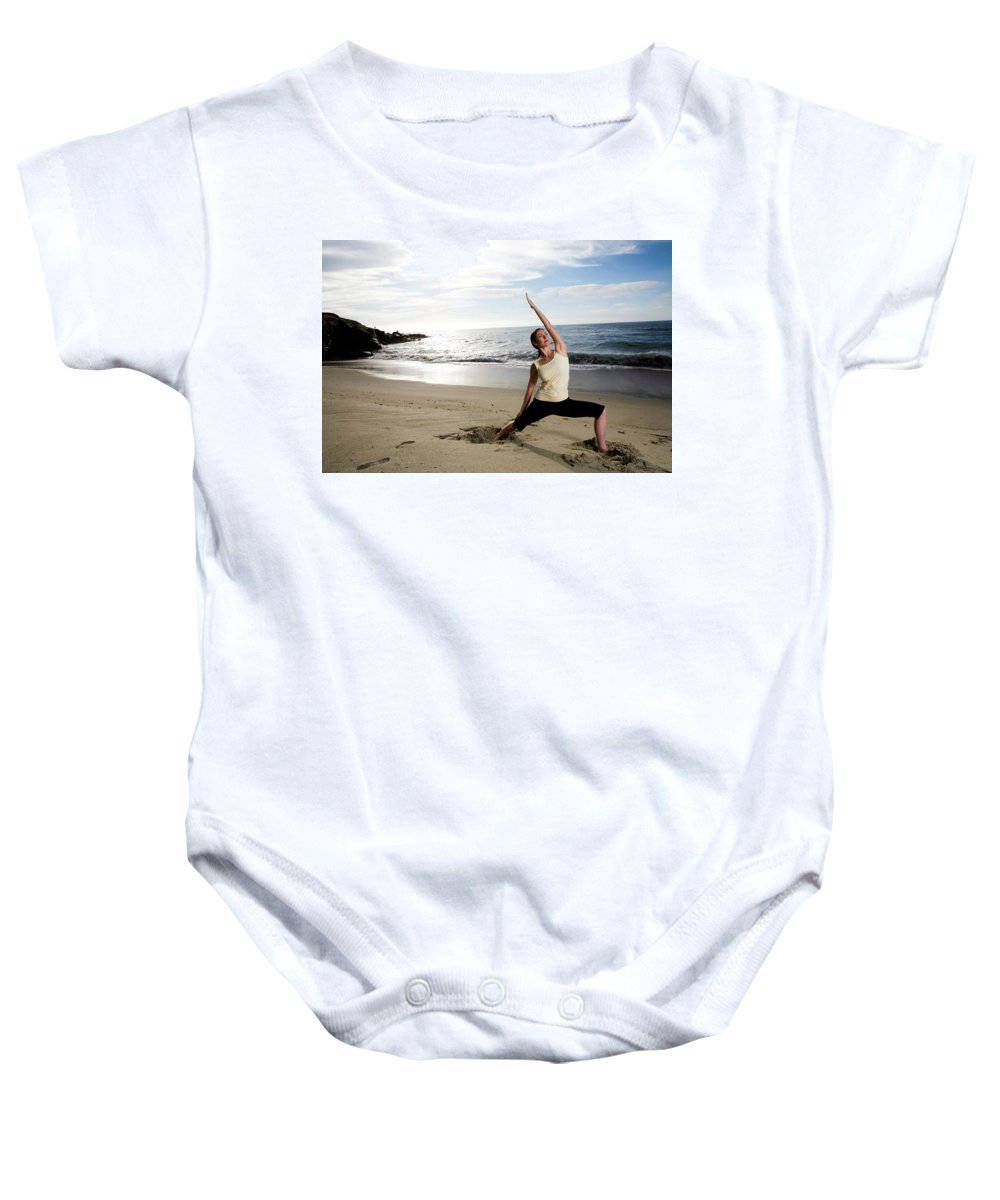 30-40 Years Old Baby Onesie featuring the photograph A Women At The Beach Performing Yoga by Jay Reilly