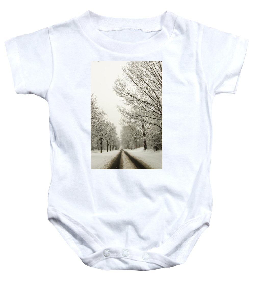 Snow Baby Onesie featuring the photograph Snow Covered Road And Trees After Winter Storm by Alex Grichenko