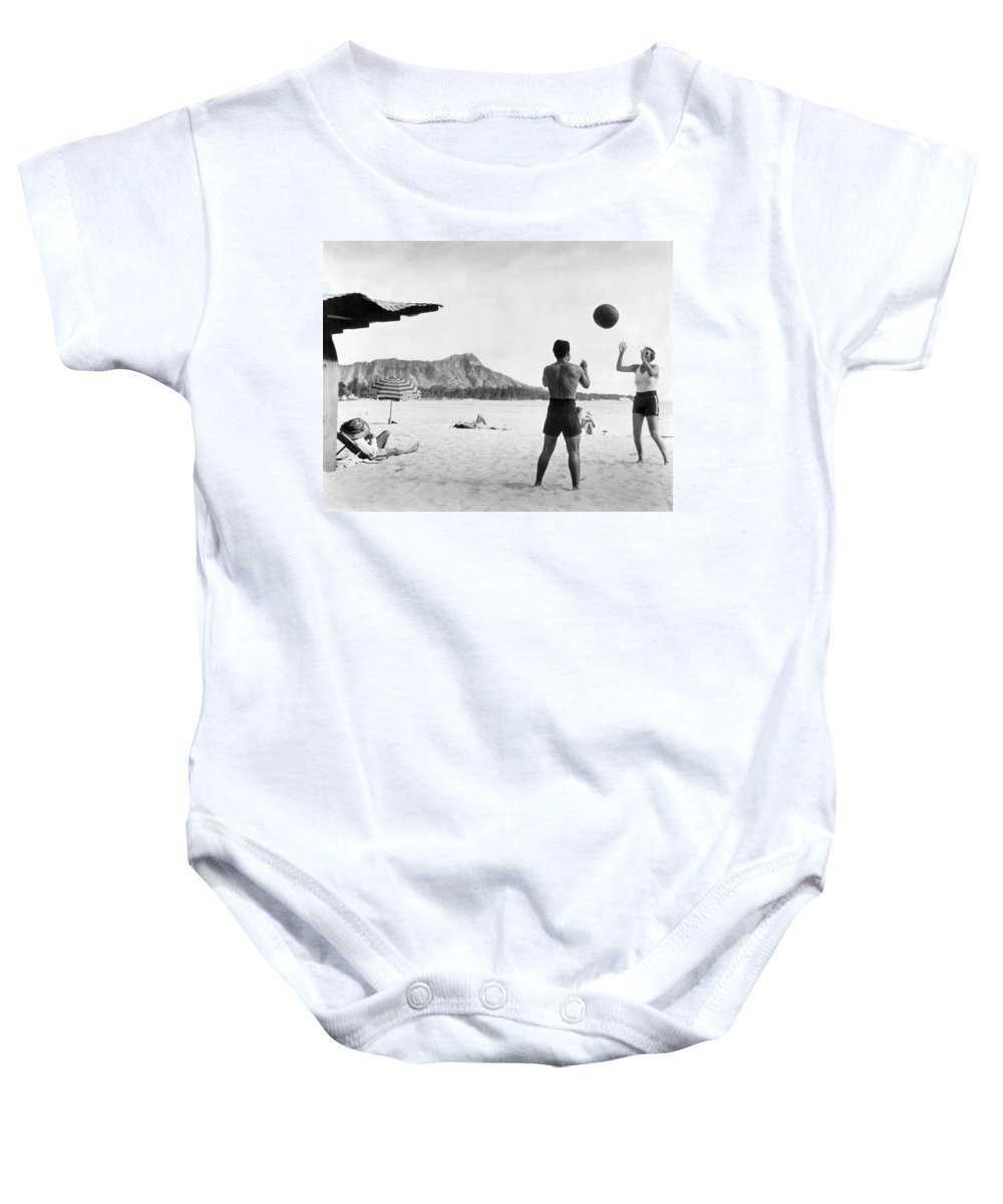 1930 Baby Onesie featuring the photograph A Couple On Waikiki Beach by Underwood Archives