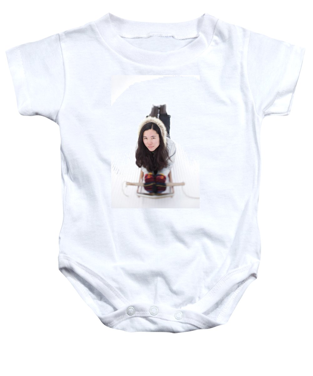 Asian Baby Onesie featuring the photograph Asian Woman Posing For A Portrait Lying by Woods Wheatcroft
