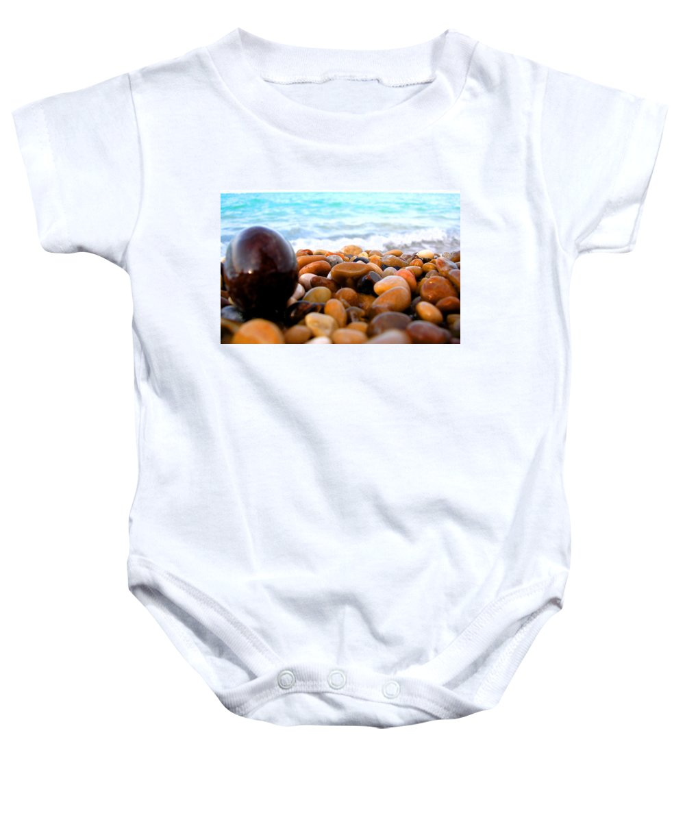 Pebble Baby Onesie featuring the photograph Black Beauty by Marcello Cicchini
