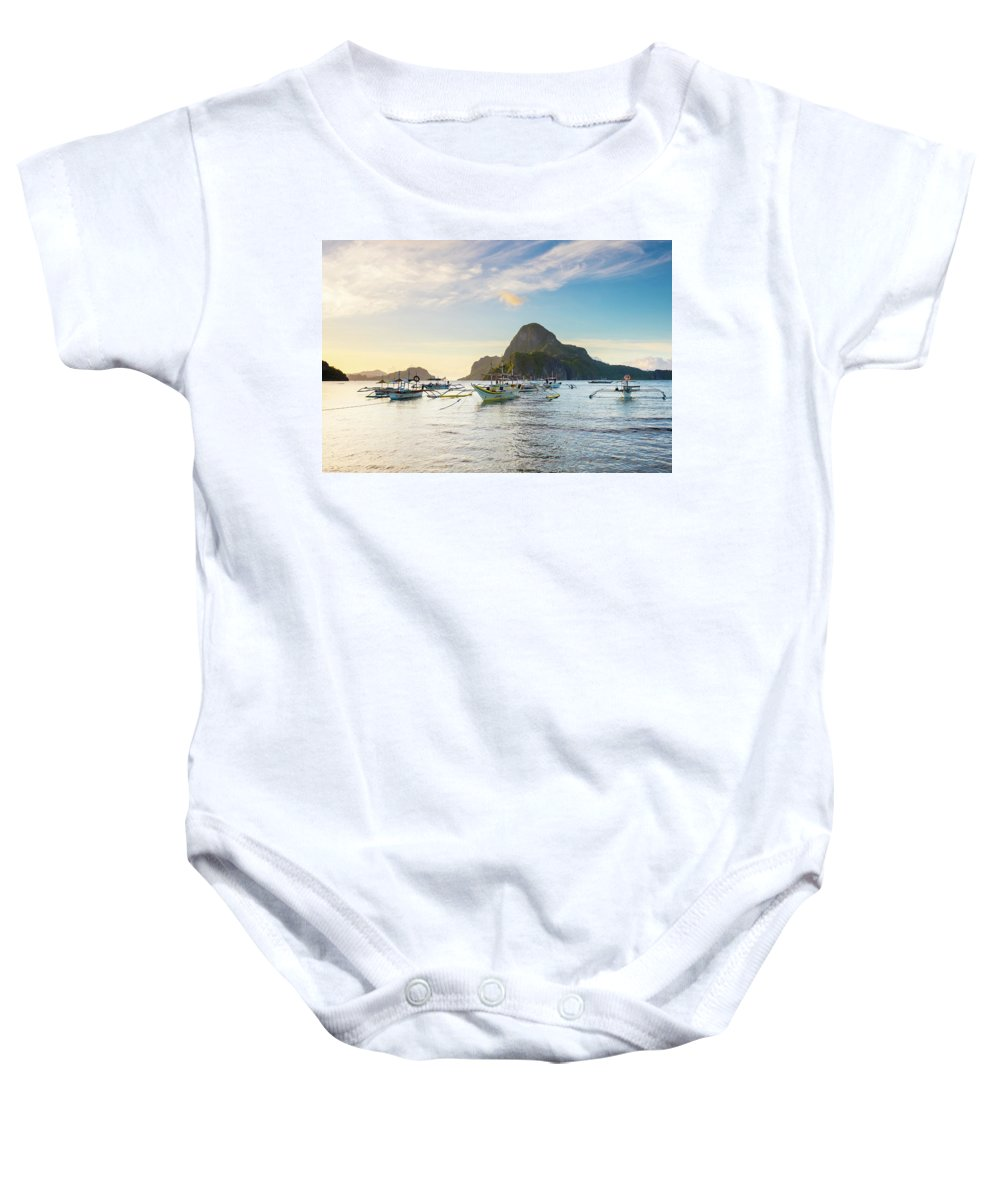 Water Baby Onesie featuring the photograph Boats Anchored In Bacuit Bay And Cadlao by Jason Langley