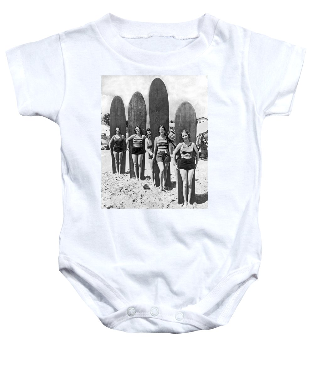 1035-515 Baby Onesie featuring the photograph California Surfer Girls by Underwood Archives