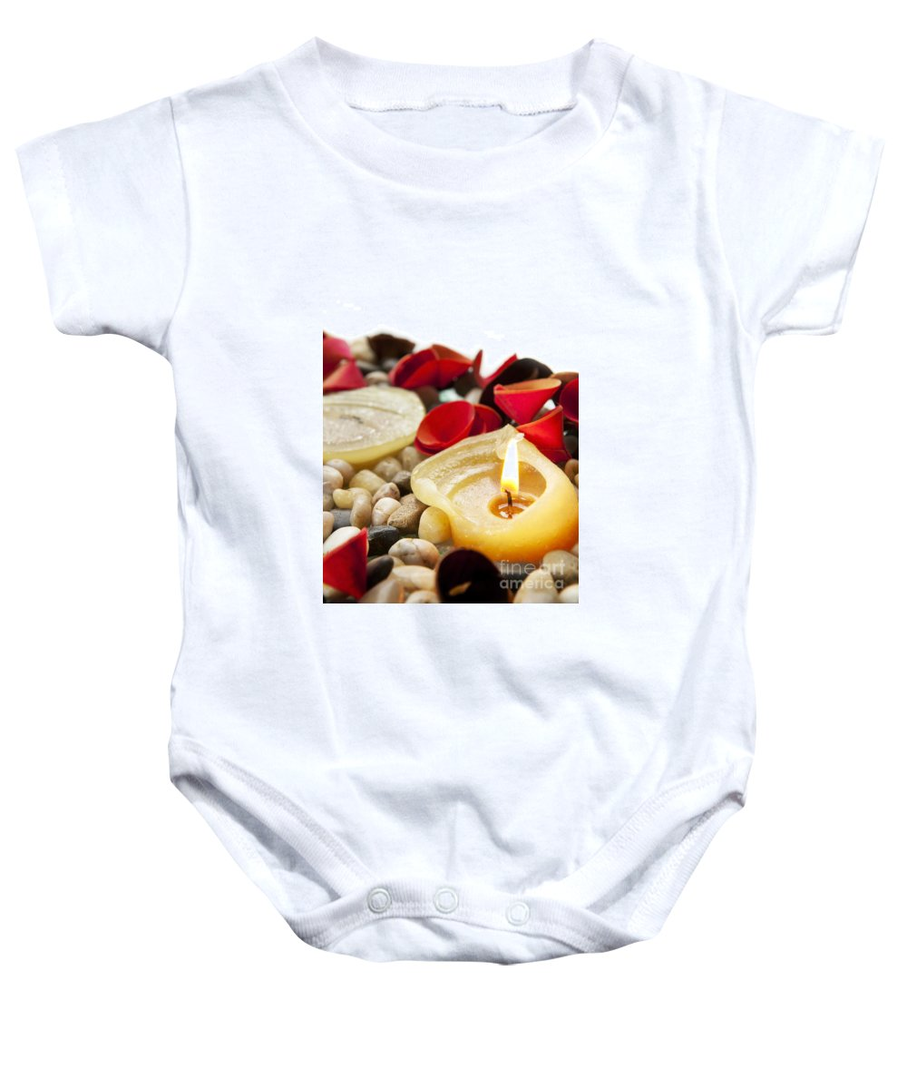 Anniversary Baby Onesie featuring the photograph Candle And Petals by Tim Hester