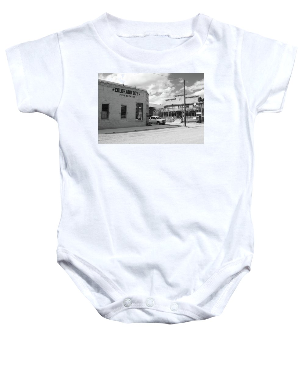 American West Baby Onesie featuring the photograph Colorado Boy by Eric Glaser