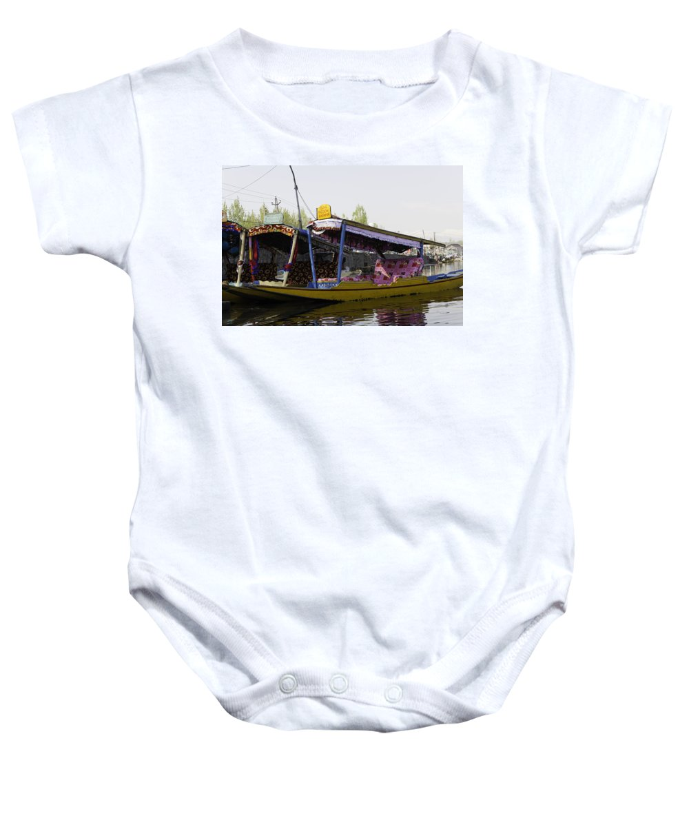 Beautiful Scene Baby Onesie featuring the photograph Colorful Shikaras Tied Up Next To The Dal Lake In Srinagar by Ashish Agarwal