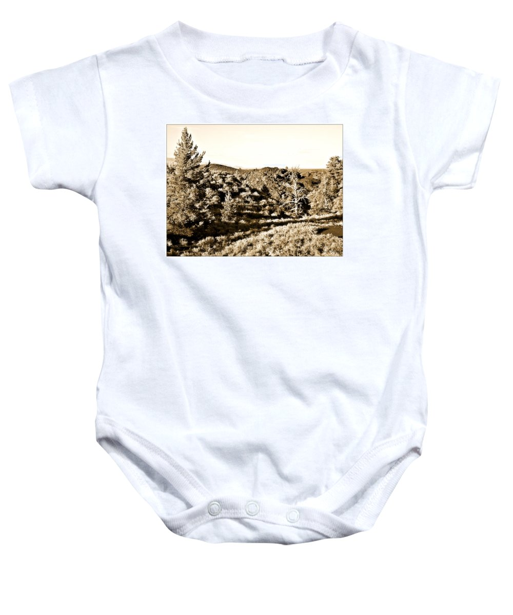 Craters Baby Onesie featuring the photograph Craters Of The Moon1 by Susan Kinney