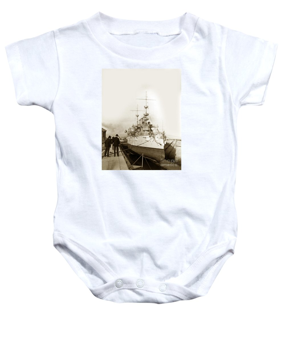 Cruiser Baby Onesie featuring the photograph Cruiser Uss New York Going Into Dry Dock San Francisco Circa 1903 by California Views Archives Mr Pat Hathaway Archives