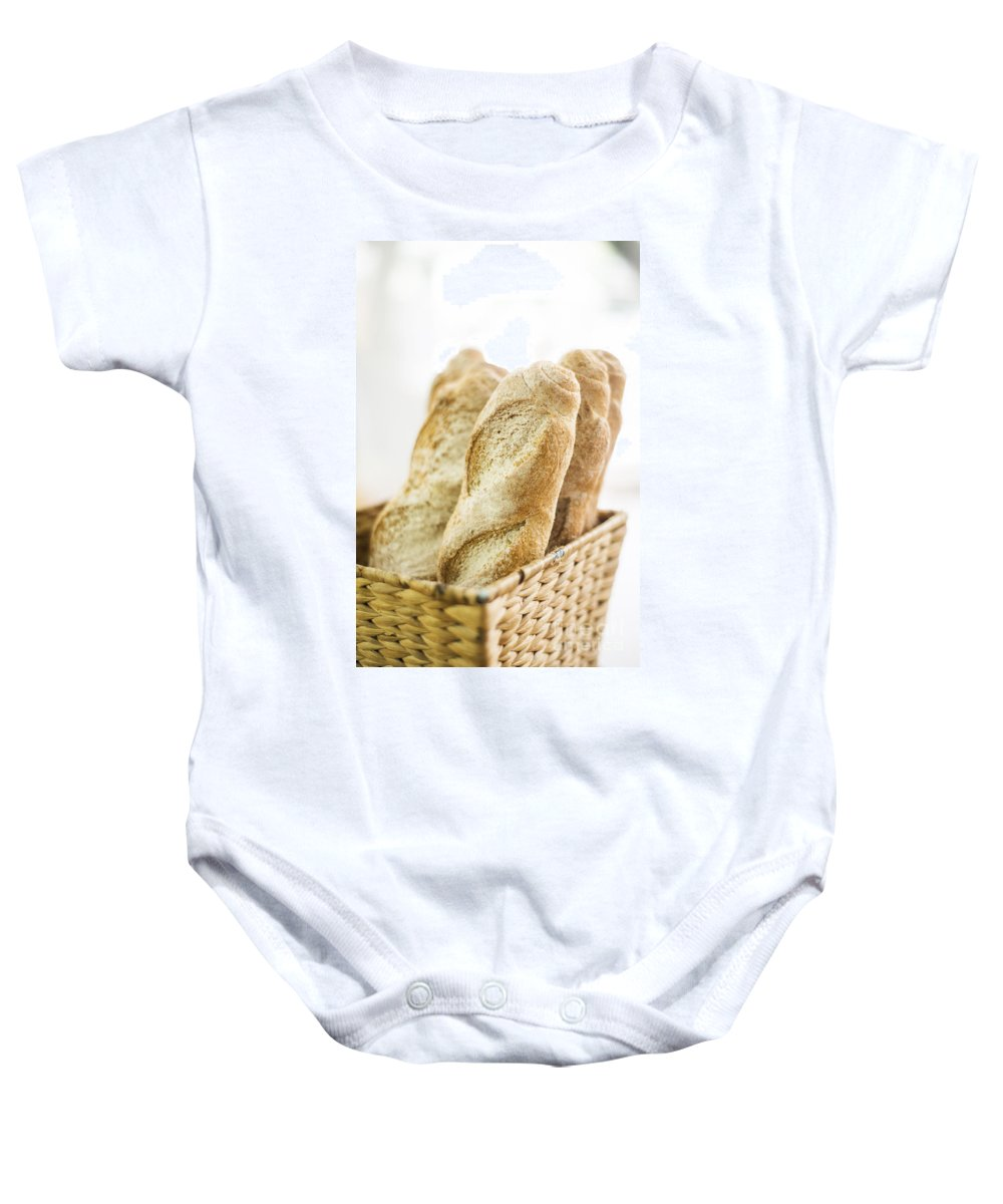 Baguette Baby Onesie featuring the photograph French Baguette In Basket by Jacek Malipan