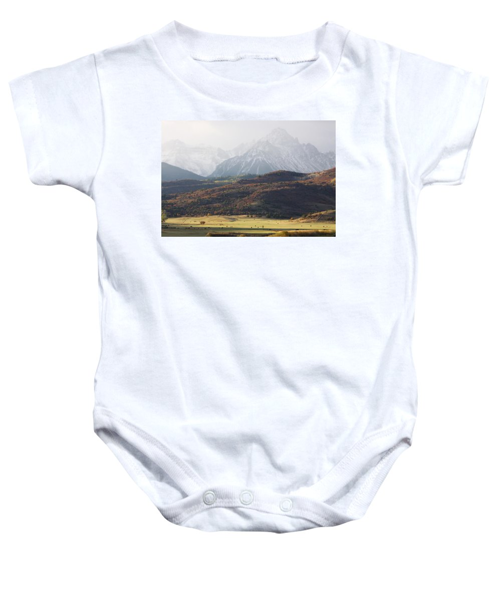 American West Baby Onesie featuring the photograph Ghost Mountains by Eric Glaser