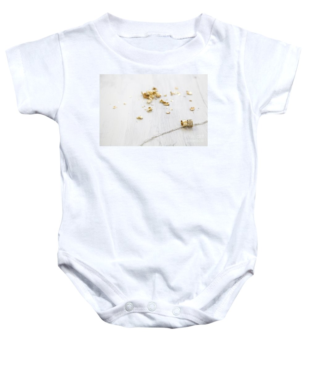 Connection Baby Onesie featuring the photograph Gold Wedding Rings by Gal Eitan