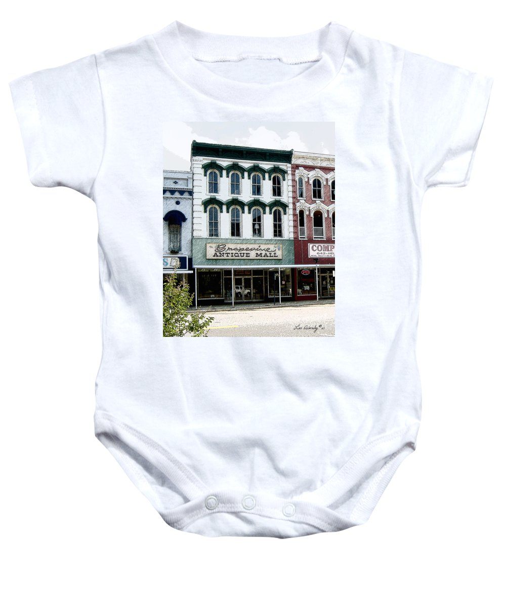 Windows On The Square Baby Onesie featuring the photograph Grapevine Antiques by Lee Owenby