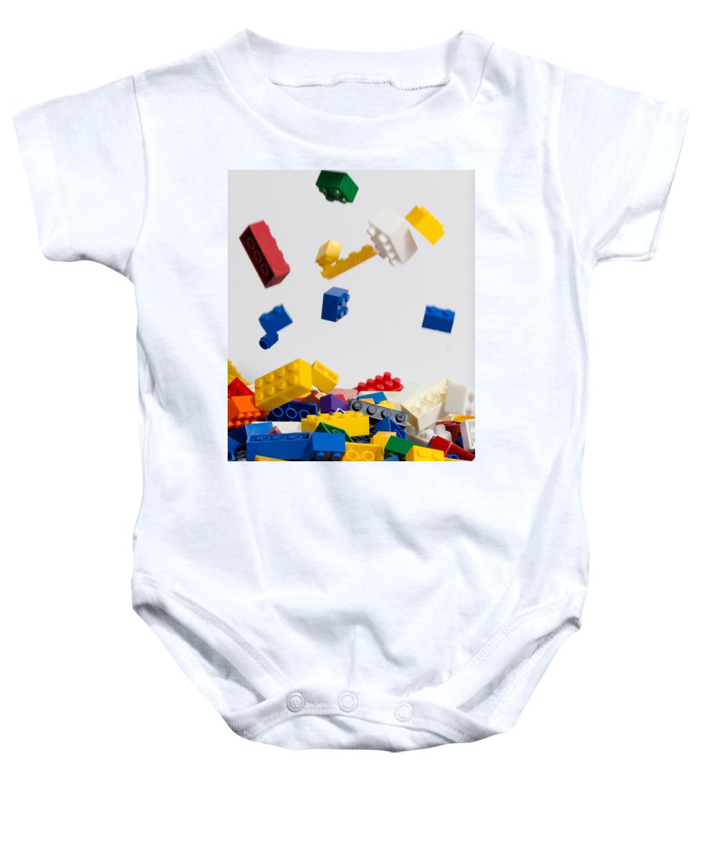 Blocks Baby Onesie featuring the photograph Helter Skelter by Leah Palmer