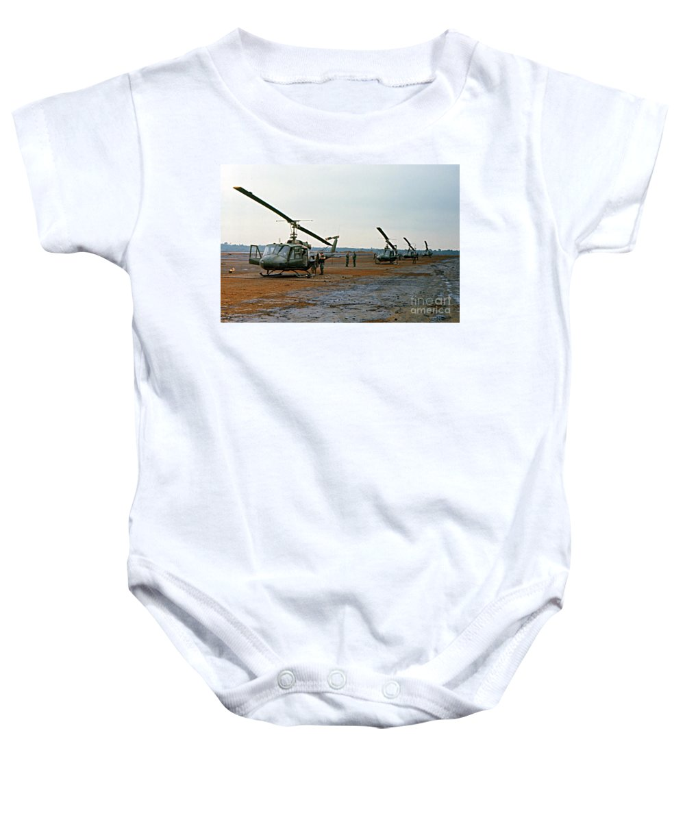 Bell Uh-1 Iroquois Baby Onesie featuring the photograph Huey Bell Uh-1 Iroquois Helicopter Pleiku Vietnam 1969 by California Views Mr Pat Hathaway Archives