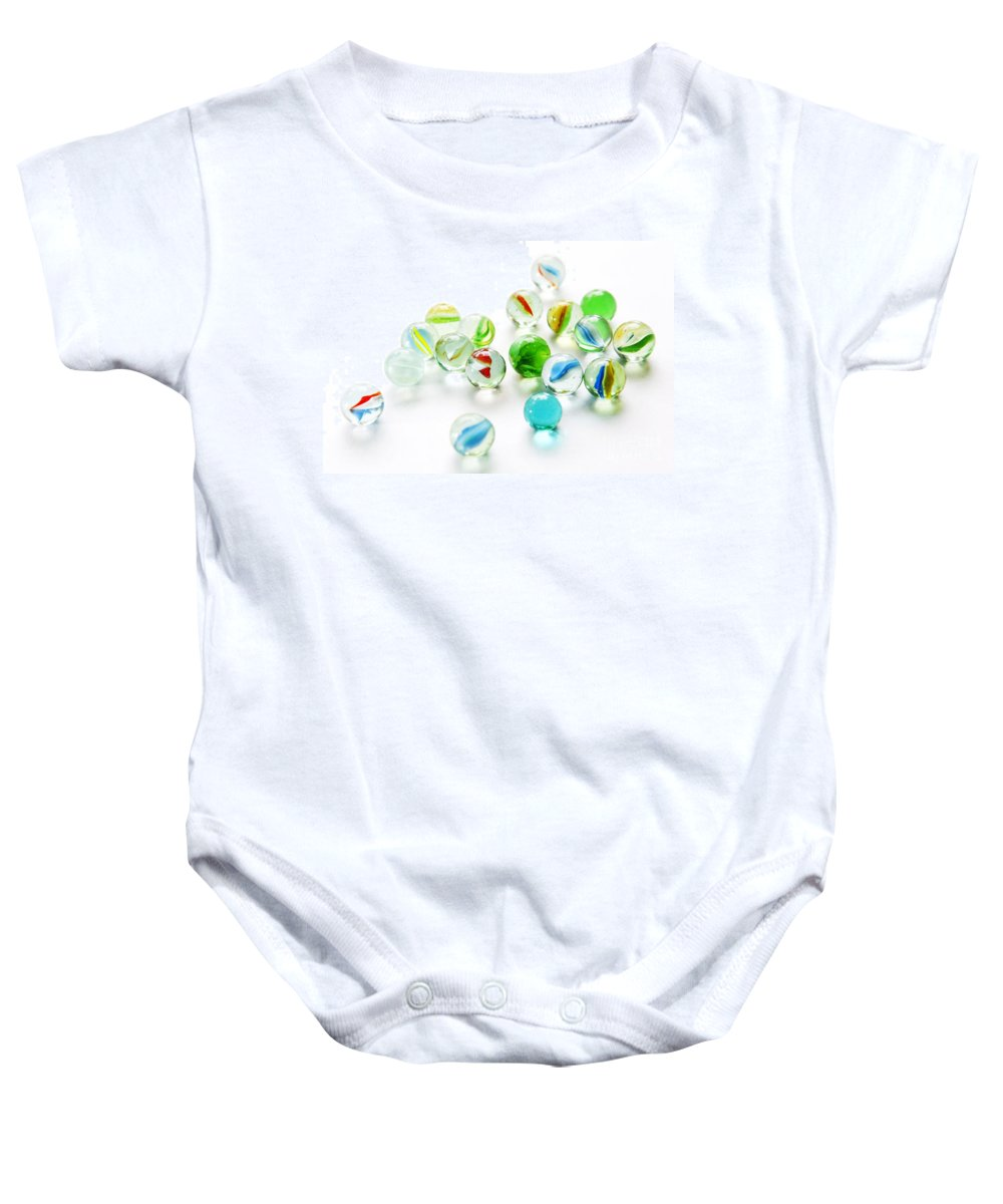 Abstract Baby Onesie featuring the photograph Isolated Marbles by Tim Hester