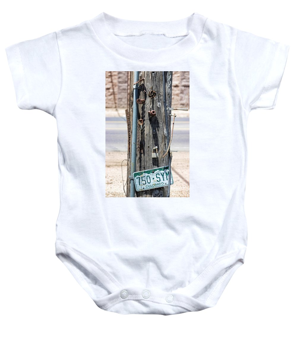 Nail Baby Onesie featuring the photograph Nailed It by Becca Buecher