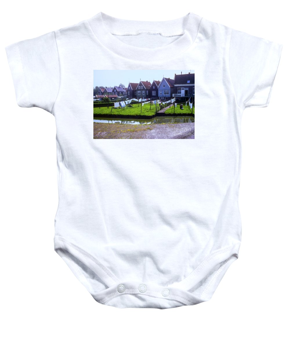 Marken Baby Onesie featuring the photograph Out To Dry by Bob Phillips