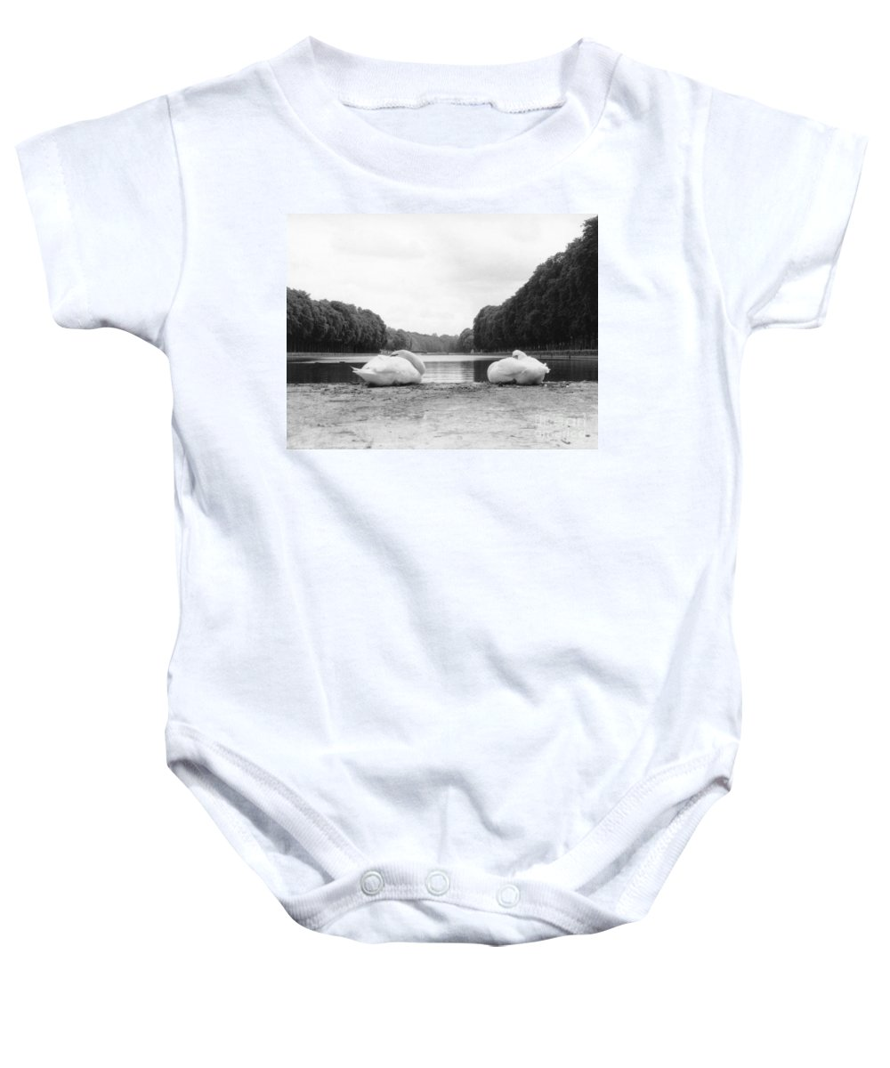 Swans Baby Onesie featuring the photograph Resting Swans by Christine Jepsen