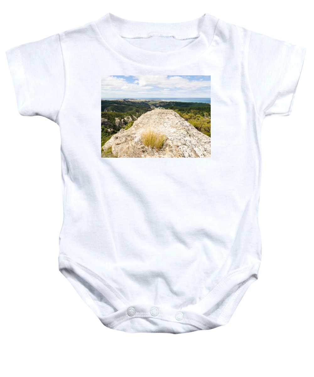 .coast Baby Onesie featuring the photograph Rocky Outcrops Of Trotters Gorge Otago Nz by Stephan Pietzko
