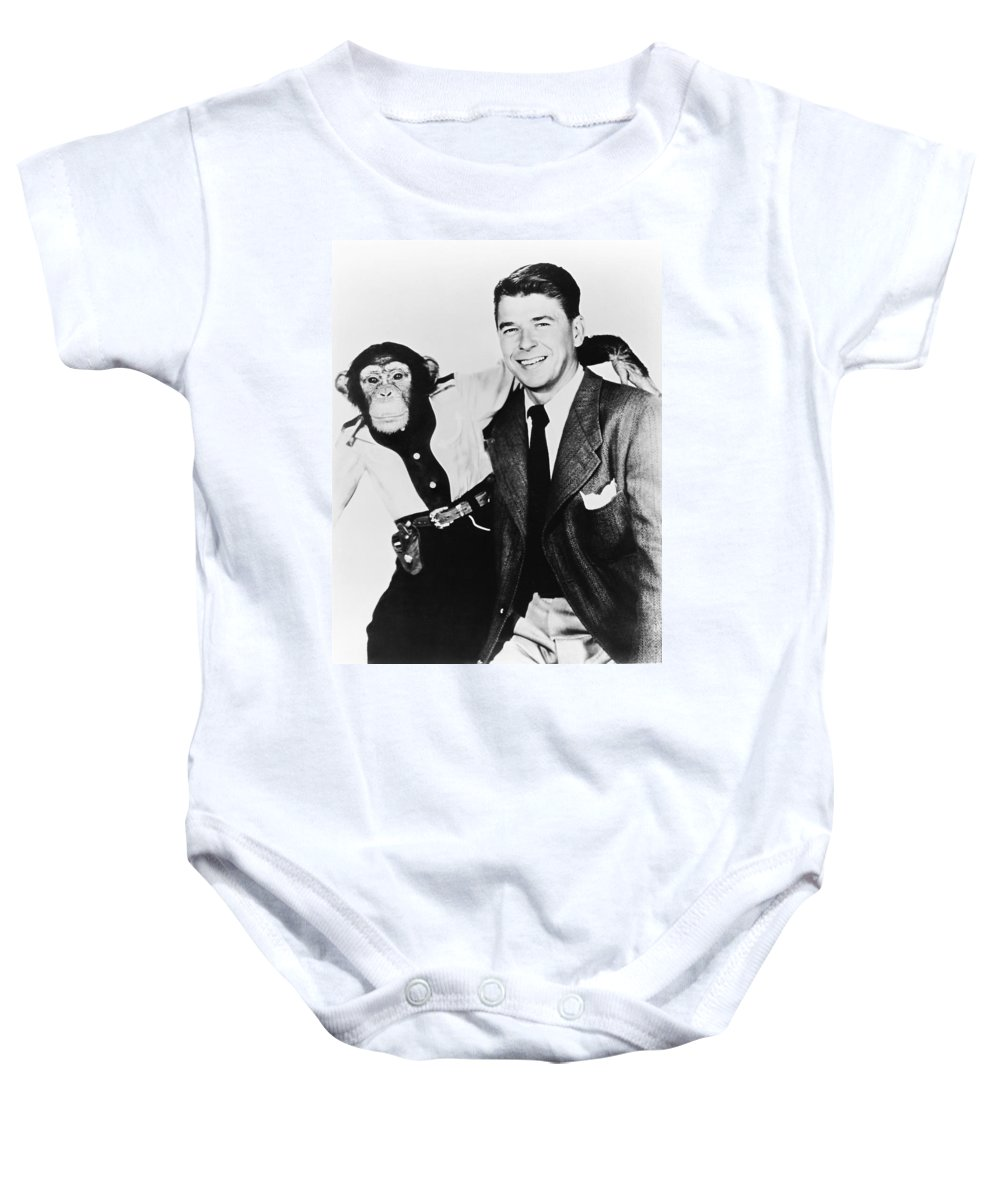 1951 Baby Onesie featuring the photograph Ronald Reagan And Bonzo by Underwood Archives
