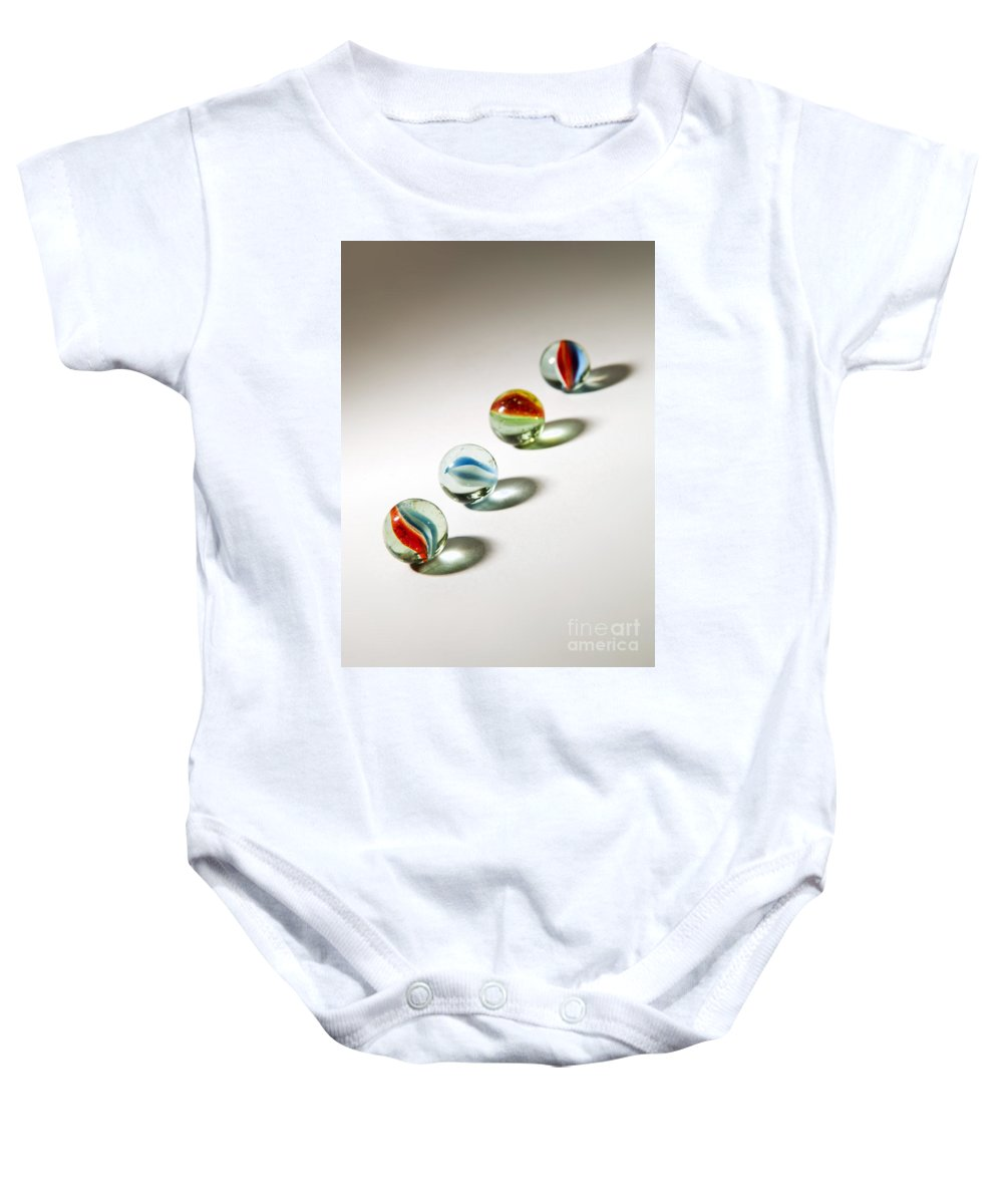 Abstract Baby Onesie featuring the photograph Shadowed Marbles by Tim Hester