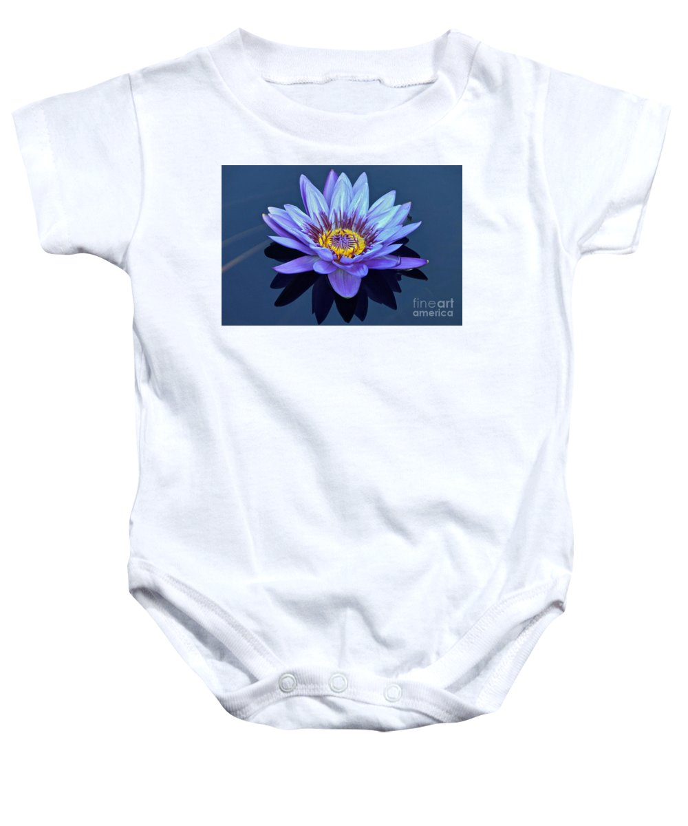 Nymphaea Baby Onesie featuring the photograph Single Lavender Water Lily by Byron Varvarigos