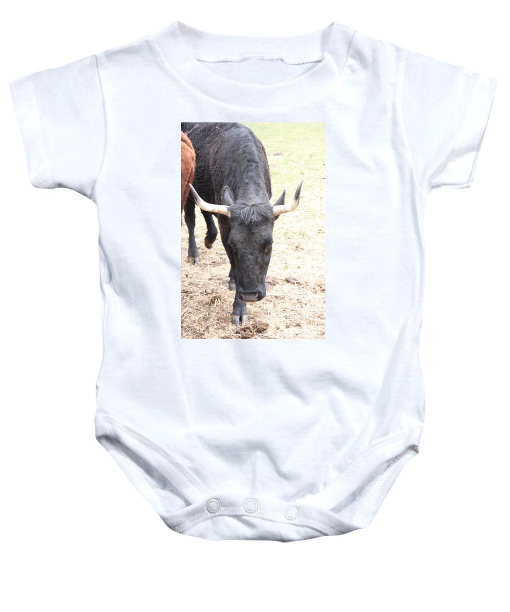 Cow Baby Onesie featuring the photograph That Ain't No Bull by Jennifer E Doll