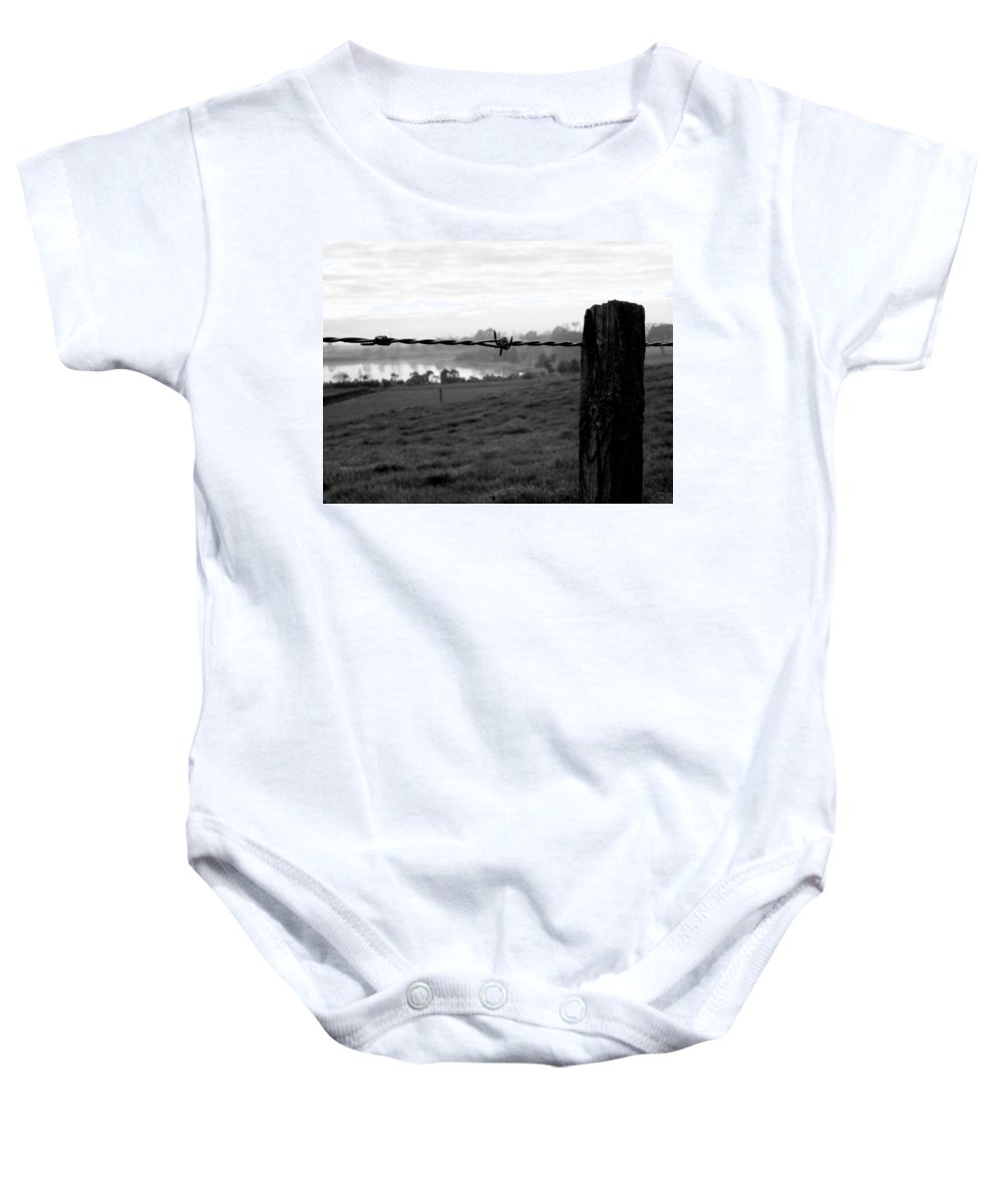 Barbed Wire Landscape New Zealand Waikato Lake Post Wood Nature Farm Rural Countryside Baby Onesie featuring the photograph Through The Fence by Guy Pettingell